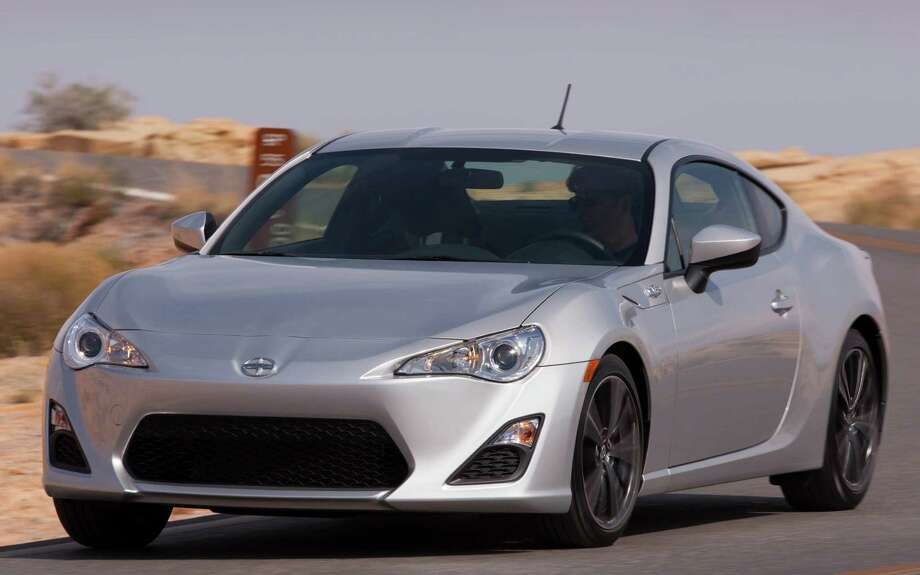 All new for 2013, the Scion FR-S marks ToyotaÕs return to the affordable sports car market. Using a boxer engine designed in collaboration with Subaru, this is a fun little car that handles very well and looks great, too. ItÕs in an attractive package with lots of standard amenities and a reasonable starting price. Photo: Toyota Motor Sales U.S.A.