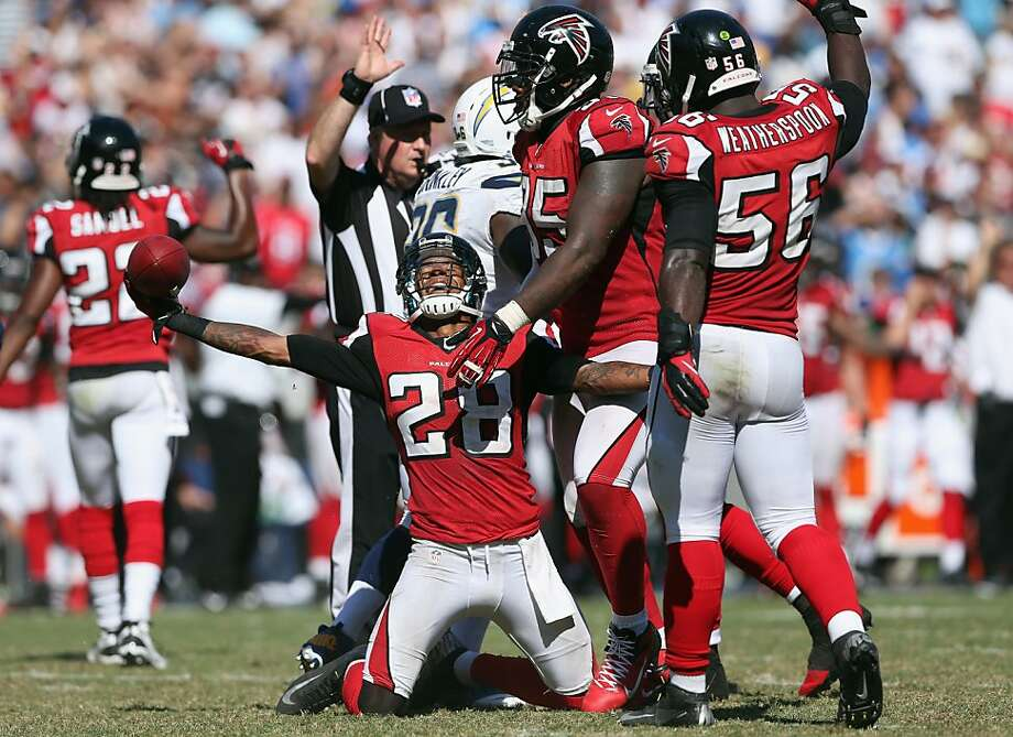 The Falcons are 4-0, thanks in part to a defense led by Thomas DeCoud (28), Jonathan Babineaux (95) and Sean Weatherspoon (56). Photo: Jeff Gross, Getty Images