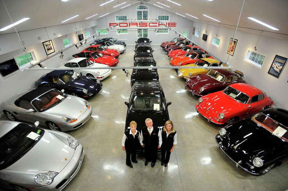 From left, Alice and Jack Gish and Kim Filler, crib manager, collect and maintain 32 Porsche models from the 1950s to the current day at the JLG Autocrib in Brookfield. Photographed on Wednesday, Oct. 4, 2012. Photo: Jason Rearick / The News-Times