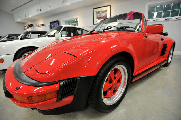 Jack and Alice Gish own a 1988 Porsche Turbo Slantnose Cabriolet. Only a handful were made in that year. Photographed on Wednesday, Oct. 3, 2012. Photo: Jason Rearick / The News-Times
