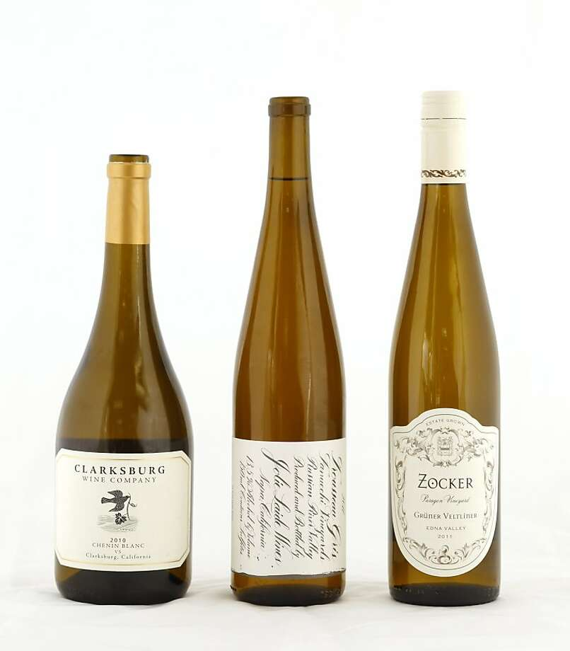 Left-right: 2010 Clarksburg Wine Co. VS Clarksburg Chenin Blanc; 2011 Jolie Laide Fanucchi Vineyards Russian River Valley Trousseau Gris; 2011 Zocker Paragon Vineyard Edna Valley Gruner Veltliner. Photo: Craig Lee, Special To The Chronicle