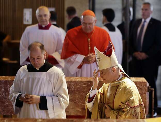Salvatore Cordileone (right) is installed as archbishop of San Francisco in St. Mary's Cathedral. Photo: Marcio Jose Sanchez, Associated Press