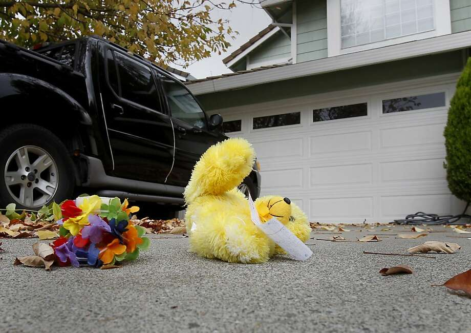 A stuffed animal and some flowers are left in the driveway where the shooting occurred on Foulkstone Way. The men often gathered in the garage. A quiet neighborhood in the Glen Cove district of Vallejo, Calif. is in shock after a resident there, Martin Hohenegger shot and killed two friends Wednesday night October 3, 2012. Photo: Brant Ward, The Chronicle