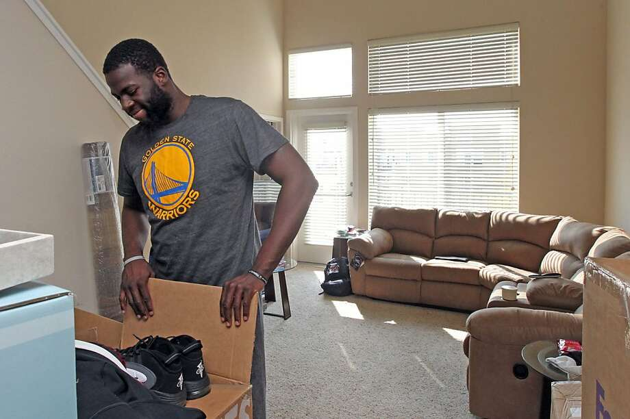Warriors rookie Draymond Green surveys his new apartment in Emeryville. Green says he's been broke his entire life, so he's not changing his ways, even with an NBA contract. Photo: Lance Iversen, The Chronicle