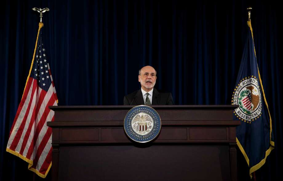 FILE-In this Thursday, Sept. 13, 2012, file photo, federal Reserve Chairman Ben Bernanke speaks during a news conference in Washington. Federal Reserve wants to find a clearer way to signal to the public when it might start raising interest rates. The Fed has told investors that it plans to keep short-term rates low for at least another three years. But it appears to be leaning toward setting a more specific target, according to minutes from the Fed's last policy meeting.  (AP Photo/Manuel Balce Ceneta. File) Photo: Manuel Balce Ceneta