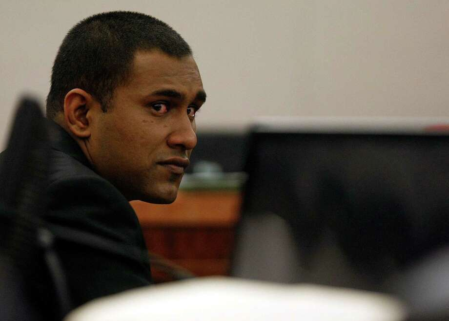 Former Houston Police officer Abraham Joseph, 28, is red-eyed after his guilty verdict was read on two counts of aggravated sexual assault, the most serious possible charge.  Photo: Johnny Hanson / © 2012  Houston Chronicle