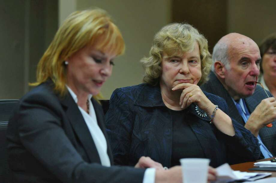 Saratoga Performing Arts Center Chairman of the Board Susan Phillips Read, center, listens to Marcia J. White, President and Executive Director, left, speak during a SPAC board meeting at the Albany-Colonie Regional Chamber of Commerce, on Oct. 4, 2012 in Colonie, NY.  Ed Lewi is at right. (Philip Kamrass /  Times Union) Photo: Philip Kamrass / 00019543A