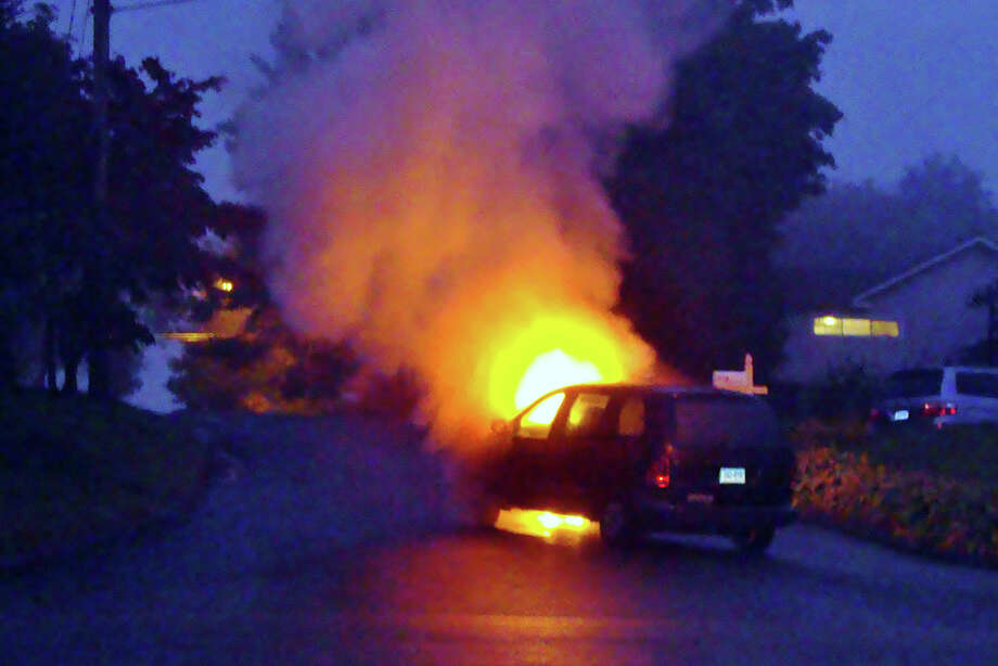 At about 7 p.m. Thursday, firefighters were called to the scene of a vehicle fire on Topstone Drive in Danbury on Thursday, Oct. 4, 2012. No injuries were reported. Photo: Contributed Photo Samantha Quatt, Contributed Photo / The News-Times Contributed