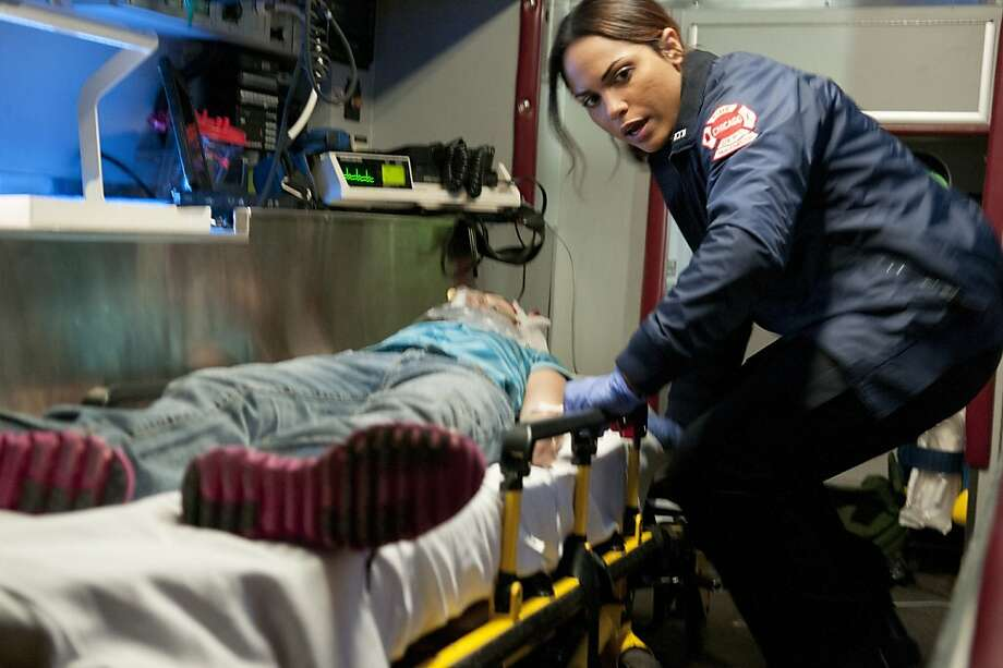 "Paramedic Gabriela Dawson (Monica Raymund) aids a patient in the new drama ""Chicago Fire."" Photo: Matt Dinerstein, NBC"