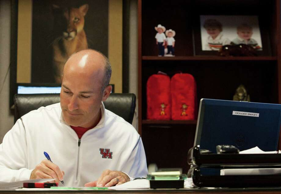 University of Houston head football coach Tony Levine works in his office after meeting with his coaching staff during the morning hours. Photo: J. Patric Schneider, For The Chronicle / © 2012 Houston Chronicle