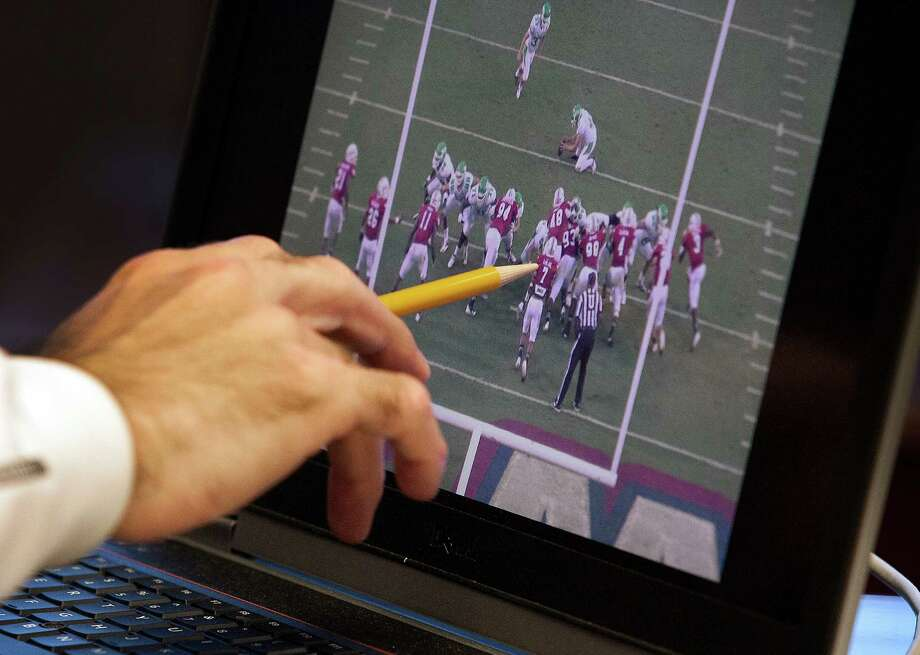 University of Houston head football coach Tony Levine reviews tape from the one  of North Texas' games earlier this seasonon Monday, Oct. 1, 2012, in Houston. (  J. Patric Schneider / For the Chronicle) Photo: J. Patric Schneider, For The Chronicle / © 2012 Houston Chronicle
