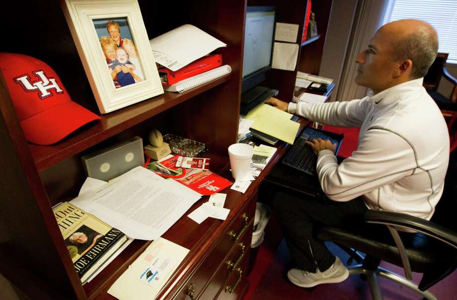 A picture of University of Houston head football coach Tony Levine's four children, Benjamin, Asher, Eli, and daughter Willa, sits on his desk as he works in his office. Photo: J. Patric Schneider, For The Chronicle / © 2012 Houston Chronicle