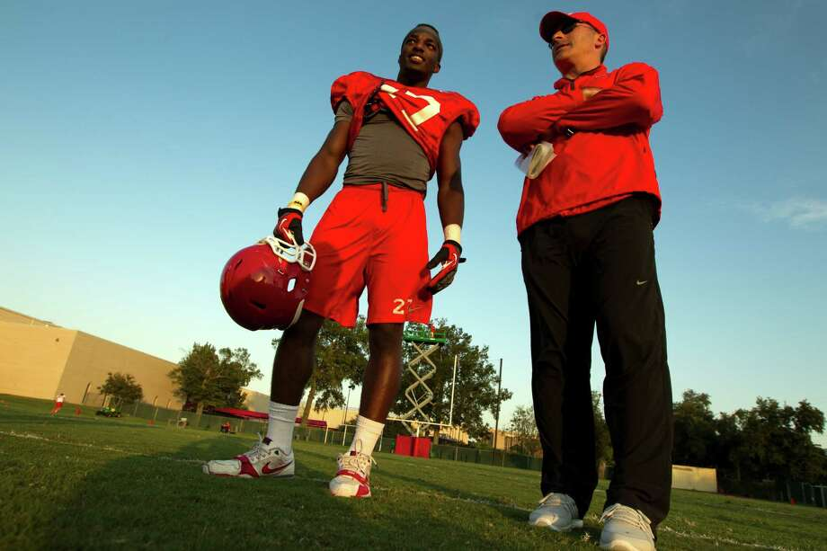 University of Houston head football coach Tony Levine talks with wide receiver Daniel Spencer (27) during afternoon practice on Monday, Oct. 1, 2012, in Houston. Photo: J. Patric Schneider, For The Chronicle / © 2012 Houston Chronicle