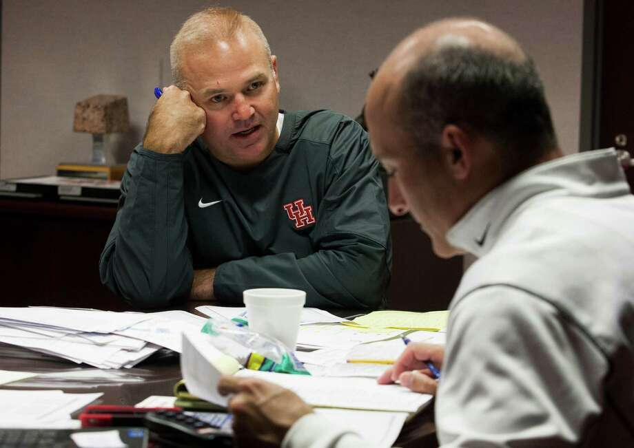 Director for Football Operations Chris Pezman talks with University of Houston Head Football Coach Tony Levine about travel arrangements for the North Texas game during the night hours on Monday, Oct. 1, 2012, in Houston. Photo: J. Patric Schneider, For The Chronicle / © 2012 Houston Chronicle
