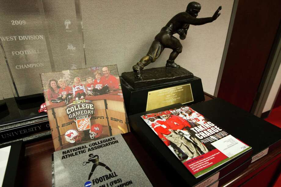 Andre Ware's 1989 Heisman Trophy is one of the items that decorates University of Houston head football coach Tony Levine's office on Monday, Oct. 1, 2012, in Houston. Photo: J. Patric Schneider, For The Chronicle / © 2012 Houston Chronicle