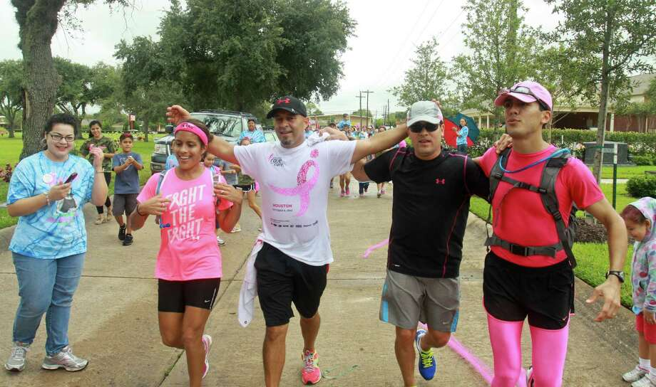 Sandra Barron Aguilar, left, Gerry Garcia, John Barron Jr. and Daniel Barron of Ana's Angels finish their 30-mile run in Pasadena that raised money for breast cancer research. Photo: Gary Fountain / Copyright 2012 Gary Fountain.