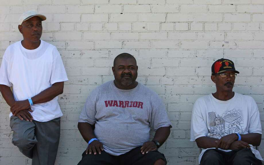 Army veteran Lamont Williams, left, Charles Whittenburg, center, and Lawrence Jackson wait in line for lunch during the Stand Down for Homeless Veterans event at Emancipation Park Community Center Thursday. Photo: James Nielsen, Chronicle / © Houston Chronicle 2012