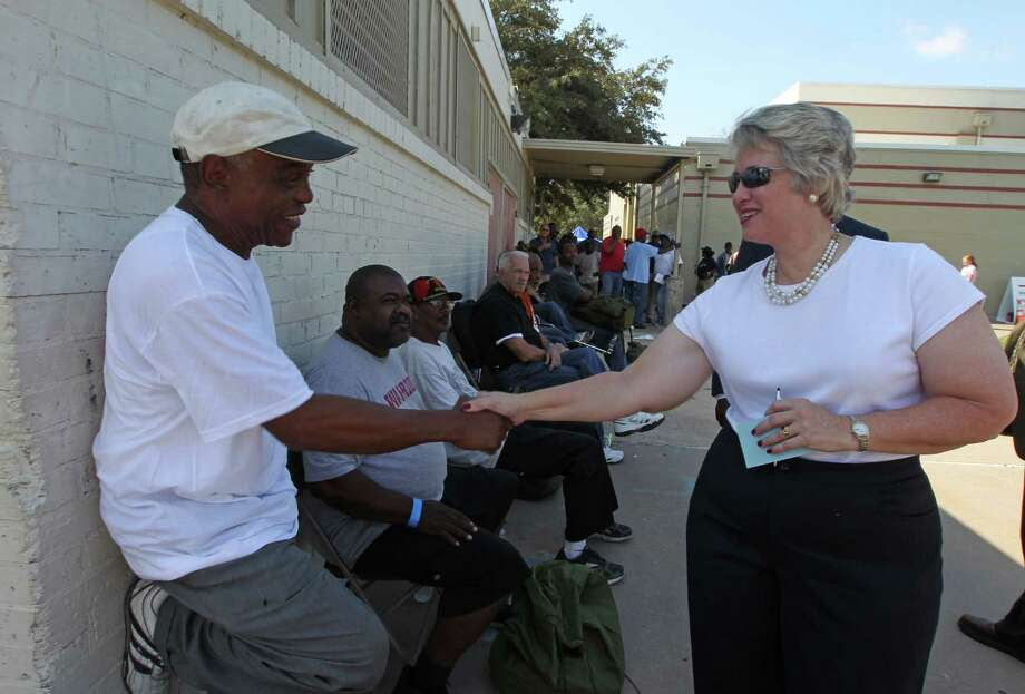 Army veteran Lamont Williams, left, speaks with Houston Mayor Annise Parker during Thursday's Stand Down for Homeless Veterans at Emancipation Park. Photo: James Nielsen, Chronicle / © Houston Chronicle 2012