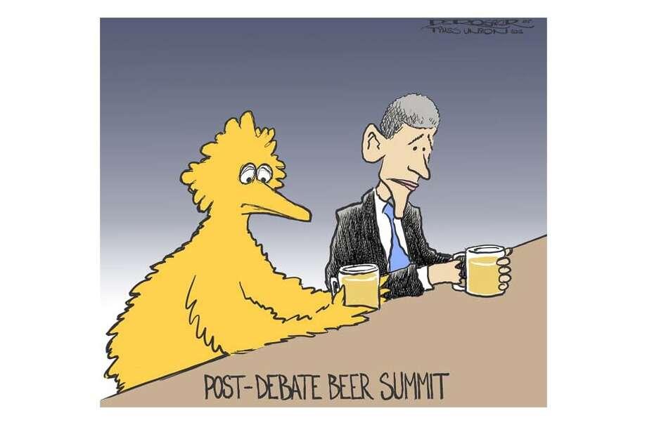 Obama loses first debate to Mitt Romney Photo: John De Rosier