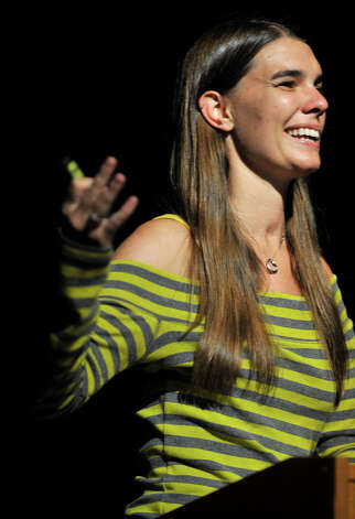 "Jacy Good speaks during her ""Hang Up and Drive"" presentation in the Newtown High School auditorium on Thursday, Oct. 4, 2012. Jacy and her parents were on their way home from Jacy's college graduation when another driver, who was allegedly distracted while talking on a cell phone, caused a large truck to enter their lane, hitting them head on. The crash killed her parents and left her traumatically injured. Photo: Jason Rearick / The News-Times"