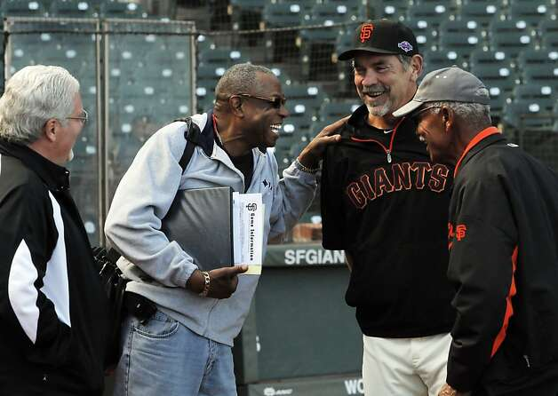 Giants general manager Brian Sabean (left) regards past and present managers Dusty Baker, Bruce Bochy and Felipe Alou. Photo: Carlos Avila Gonzalez, The Chronicle