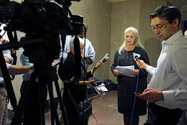 Larysa Dyrszka, a retired doctor, joins UAlbany scientist and others to call on the governor to order an independent review of the DEC's hydrofracking health impact study during a press conference at the Capitol Thursday, Oct. 4, 2012 in Albany, N.Y. (Lori Van Buren / Times Union) Photo: Lori Van Buren