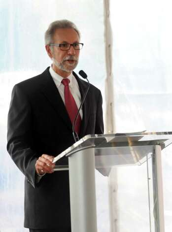 Vin Tufo, Executive Director and CEO of Charter Oak Communities, speaks during a ceremony to discuss a collaborative effort between Stamford Hospital and Charter Oak Communities to revitalize the west side at Stamford Hospital on Thursday, October 4, 2012. Photo: Lindsay Niegelberg / Stamford Advocate