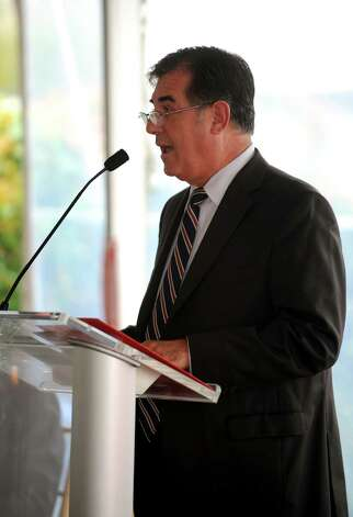 Stamford Mayor Michael Pavia speaks during a ceremony to discuss a collaborative effort between Stamford Hospital and Charter Oak Communities to revitalize the west side at Stamford Hospital on Thursday, October 4, 2012. Photo: Lindsay Niegelberg / Stamford Advocate