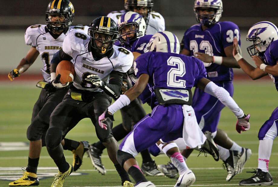 Brennan running back Nathaniel Wells Jr. takes on Brackenridge defender James Harris (2) Thursday at Alamo Stadium. Photo: Tom Reel, San Antonio Express-News / ©2012 San Antono Express-News