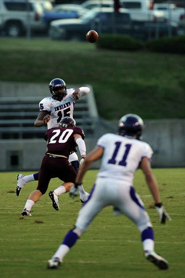 Indians quarterback A.J. Smith passes to wide receiver Logan Chipman at Silsbee High School on Friday, August 31, 2012. Photo taken: Randy Edwards/The Enterprise Photo: Randy Edwards, Photojournalist / Enterprise