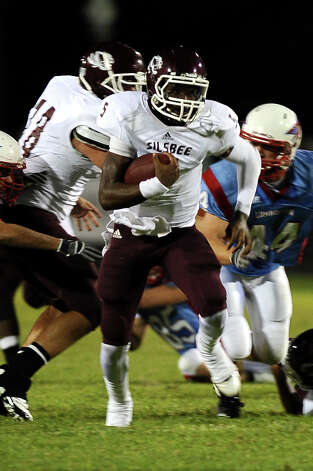 Silsbee quarterback Patrick Reed charges for a first down against Lumberton at Lumberton High School on Friday, September 14, 2012. Photo taken: Randy Edwards/The Enterprise Photo: Randy Edwards