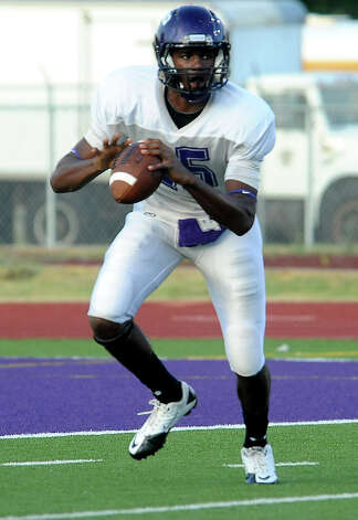 White's A.J. Smith looks to pass during the Purple vs White spring game at PNG in Port Neches, Friday. Tammy McKinley/The Enterprise Photo: TAMMY MCKINLEY