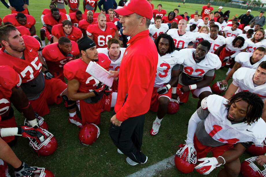 Tony Levine, center, was about halfway through his 18-hour shift as UH's football coach Monday when the Cougars took the field for an 80-minute practice session to begin preparations for Saturday's game against North Texas. Photo: J. Patric Schneider / © 2012 Houston Chronicle
