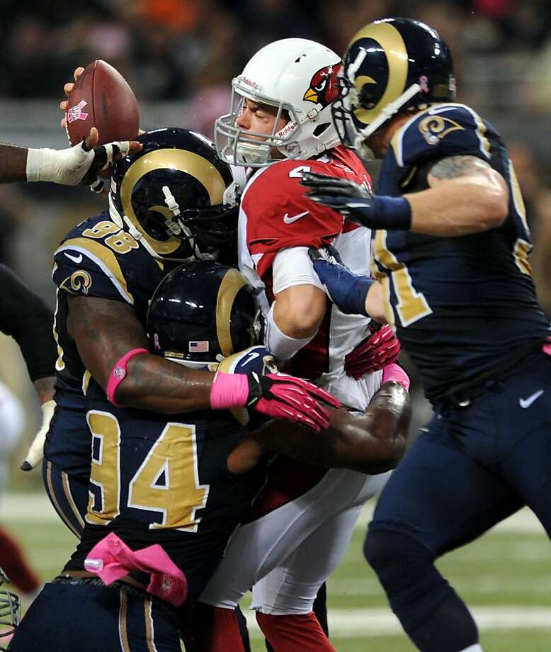 Cardinals quarterback Kevin Kolb (center) was under pressure all night; the Rams had nine sacks. Photo: L.G. Patterson, Associated Press