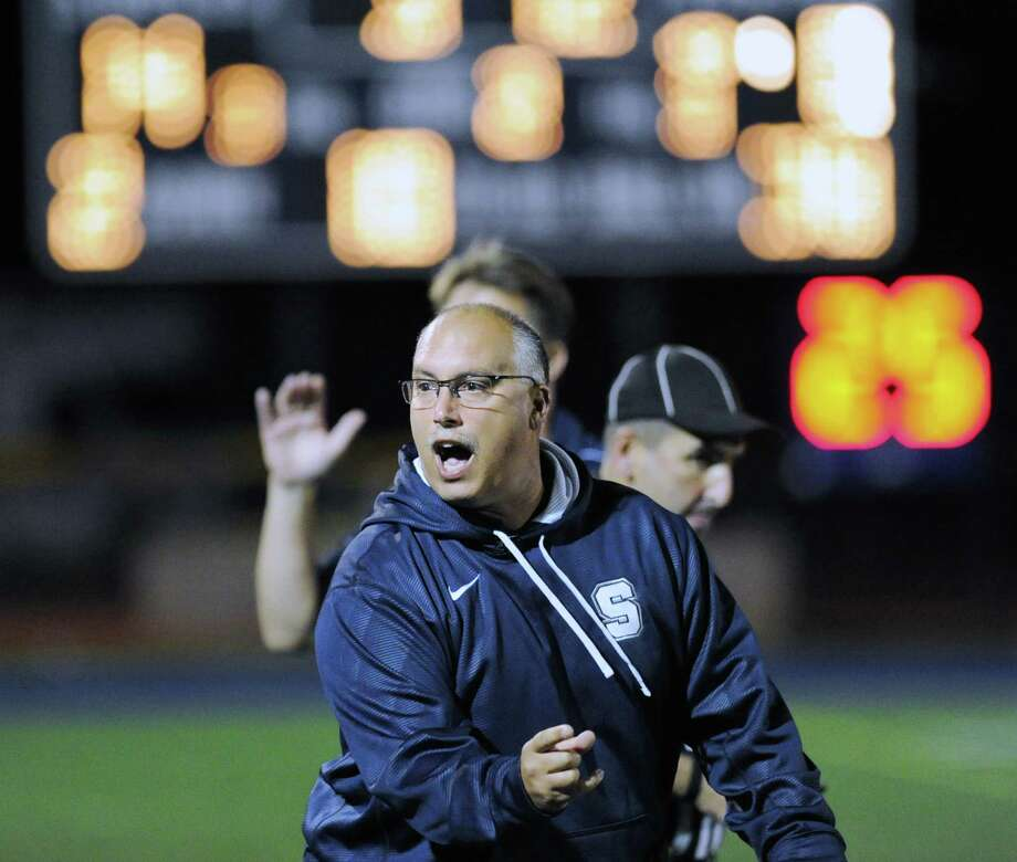 Staples High School Head Football Coach Marce Petroccio reacts after his team scored its second touchdown of the game during high school football game between Staples High School and Bridgeport Central High School at Staples in Westport, Friday night, Sept. 21, 2012. Photo: Bob Luckey / Greenwich Time