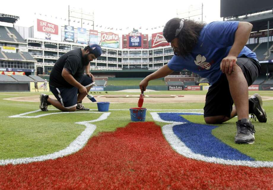Groundskeepers prepare Rangers Ballpark in Arlington for the wild-card matchup. Photo: Richard W. Rodriguez / FR170526 AP