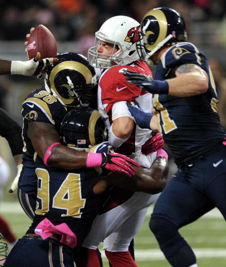 The Cardinals' Kevin Kolb, center, is sacked by Rams defensive end Robert Quinn (94) with help from Kendall Langford (98) and Chris Long. Photo: L.G. Patterson / FR23535 AP