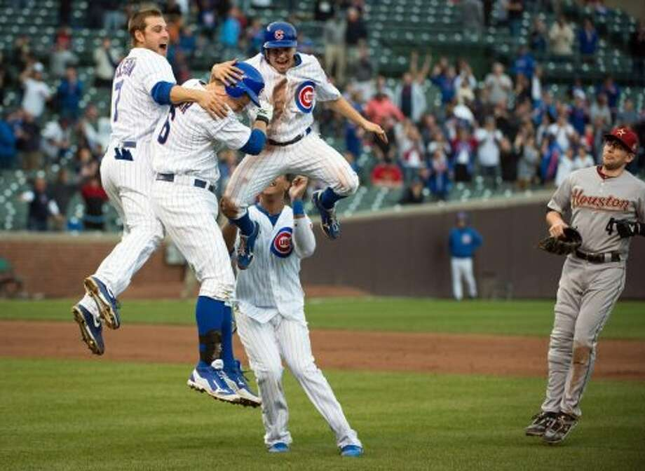 Oct. 3: Cubs 5, Astros 4Cubs first baseman Bryan LaHair (6) celebrates with Brett Jackson, Tony Campana and Starlin Castro as Astros shortstop Jed Lowrie (4) walks away after LaHair's single in the bottom of the ninth inning gave the Cubs a 5-4 victory over the Astros at Wrigley Field in Chicago.  The Cubs victory sent the Astros to a franchise record 107th loss in a game that marked their final game as a National League team.  (Smiley N. Pool / Houston Chronicle)