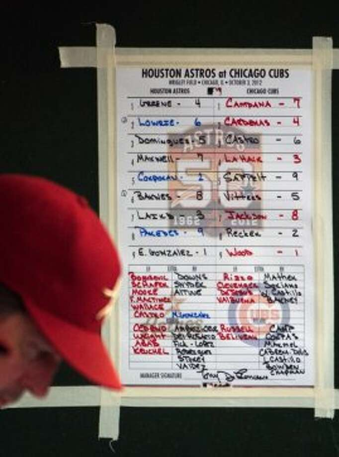 The Astros lineup card hangs on the wall of the visitors dugout as the team faces the Chicago Cubs at Wrigley Field, The season finale marked the Astros final game as a National League team. (Smiley N. Pool / Houston Chronicle)