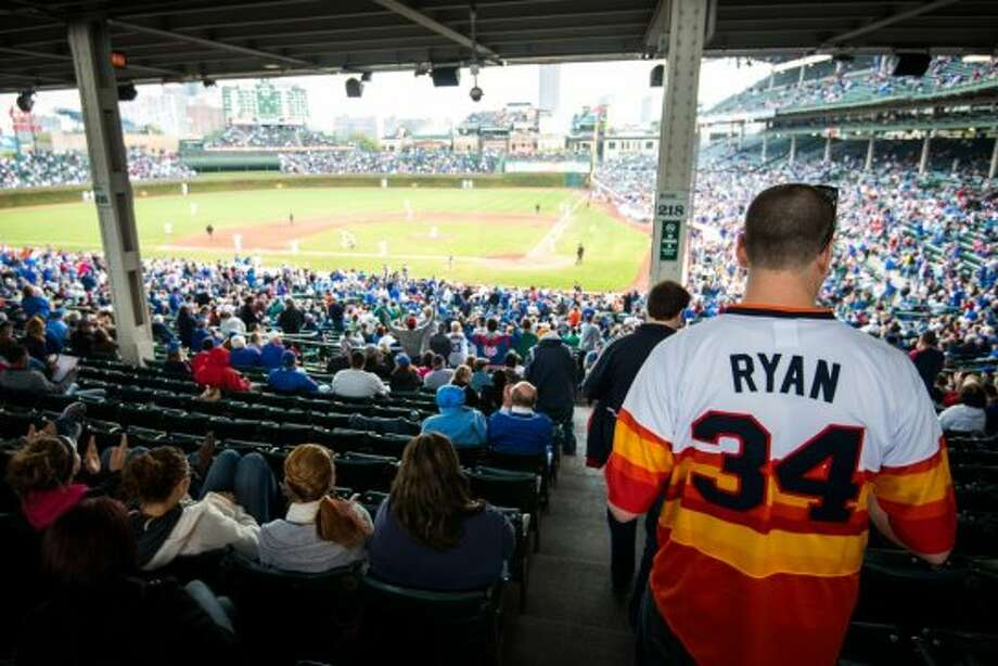 Chris Nielsen wears a number 34 Houston Astros Nolan Ryan jersey as he heads to his seat at Wrigley Field.  Nielsen, who is from Michigan, said he wasn't really an Astros fan, he just really liked the vintage rainbow jersey.  (Smiley N. Pool / Houston Chronicle)
