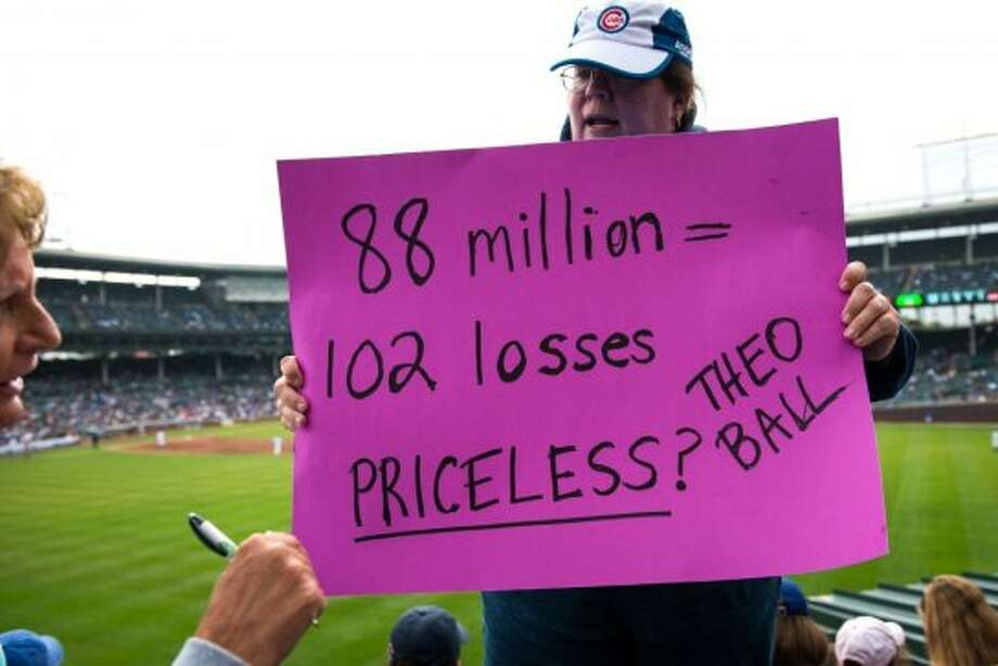 Cubs fans prepare a sign in the event of their team losing the game during the fifth inning against the Houston Astros at Wrigley Field. The season finale marked the Astros final game as a National League team. The Cubs ended with 101 losses, second-most in franchise history. (Smiley N. Pool / Houston Chronicle)
