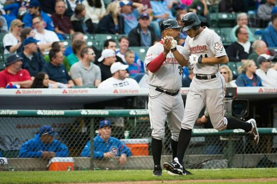 Astros outfielder Justin Maxwell rounds the bases after hitting a 3-run home run to tie the game during the eighth inning. (Smiley N. Pool / Houston Chronicle)