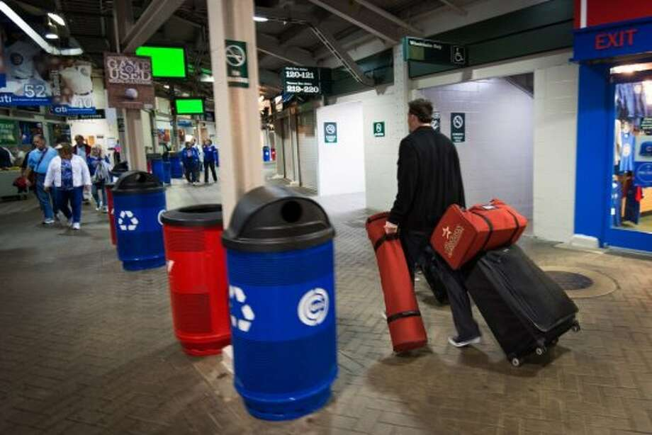 Astros infielder Tyler Greene walks through the stadium concourse with his equipment and luggage as he departs Wrigley Field after a 5-4 loss to the Chicago Cubs in the season finale. (Smiley N. Pool / Houston Chronicle)