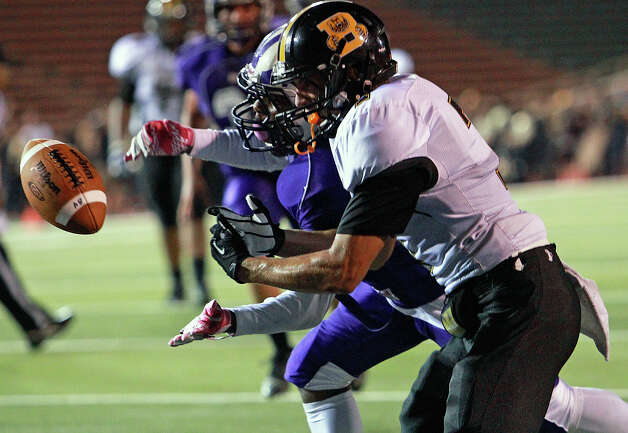 A pass to the end zone intended for Dillon Gaiton (right) of the Bears is broken up by Troy Mathis as Brackenridge hosts Brennan at Alamo Stadium on October 4, 2012. Photo: Tom Reel, San Antonio Express-News / ©2012 San Antono Express-News