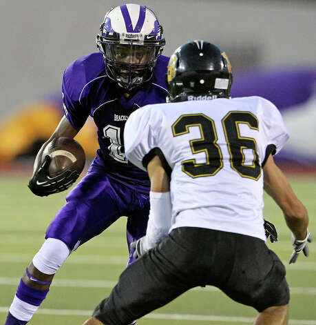 Eagles receiver Montae Whorton faces off with Joel Silva as Brackenridge hosts Brennan at Alamo Stadium on October 4, 2012. Photo: Tom Reel, San Antonio Express-News / ©2012 San Antono Express-News