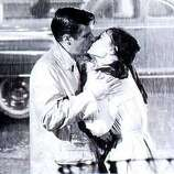"""George Peppard and Audrey Hepburn in the last scene of """"Breakfast at Tiffany's."""" (Paramount Pictures 1961)"""
