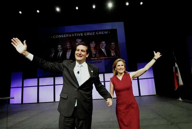 U.S. Senate Candidate Ted Cruz, left, and his wife Heidi Cruz wave as they take the stage for a speech during the Texas Republican Convention in Fort Worth, Texas,  Saturday, June 9, 2012. Photo: LM Otero, AP / AP