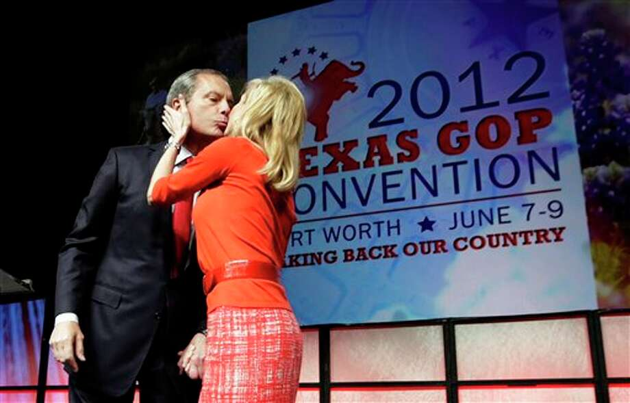 Texas Lt. Gov. David Dewhurst, left, gets a kiss from his wife Tricia Dewhurst before he speaks to the Texas Republican Convention in Fort Worth, Texas, Friday, June 8, 2012. Photo: LM Otero, AP / AP