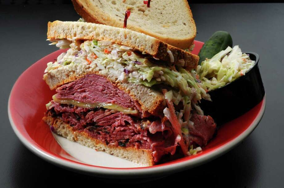 The Elliot triple decker sandwich on rye bread, with hot pastrami and corned beef, Swiss cheese, cole slaw and Russian dressing, at Nosh NY Delicatessen on Tuesday Oct. 2, 2012 in Guilderland, NY. (Philip Kamrass / Times Union) Photo: Philip Kamrass / 00019507A