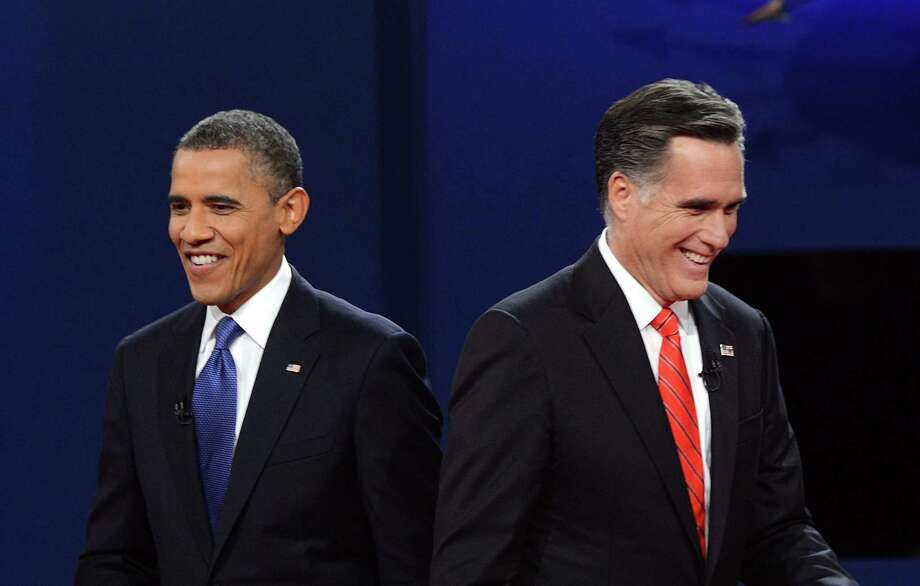 TOPSHOTS US President Barack Obama (L) and Republican presidential candidate Mitt Romney finish their debate at the University of Denver in Denver, Colorado, October 3, 2012. After hundreds of campaign stops, $500 million in mostly negative ads and countless tit-for-tat attacks,  Obama and Romney go head-to-head in their debut debate.    AFP PHOTO / Saul LOEBSAUL LOEB/AFP/GettyImages Photo: SAUL LOEB / AFP